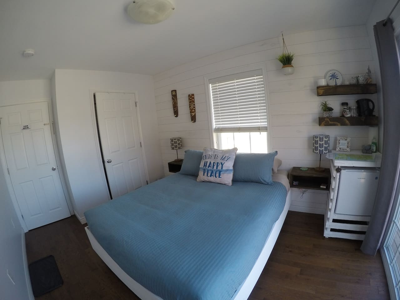 This shows your entire private space. Bedroom with en-suite bathroom and private double locked door on the left. Behind the camera is the private deck. This suite is on the second level.