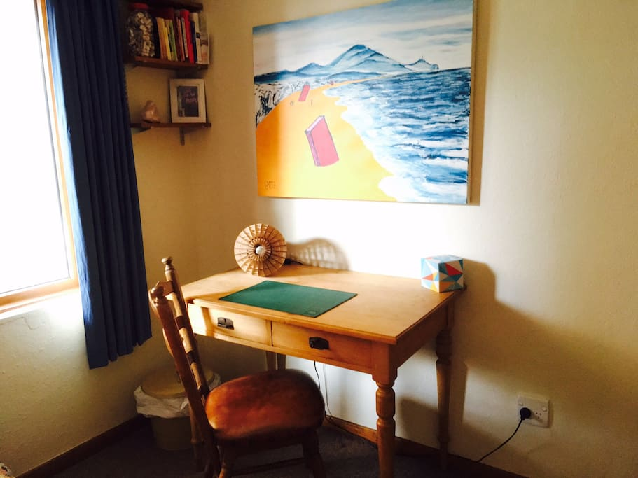The Hemingway room offers a desk, chair and lamp for those that require less distractions.