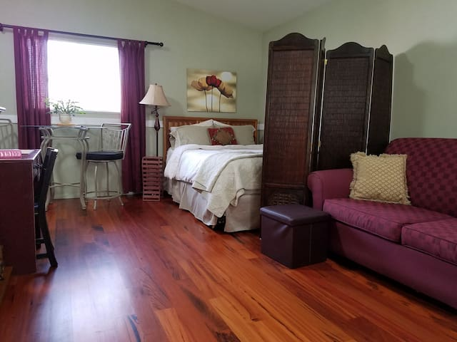 Carriage House with beautiful wood floor