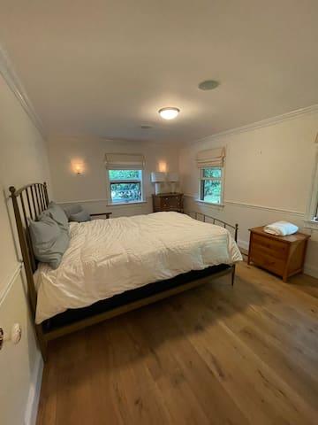 Another main floor bedroom with queen bed.