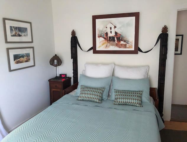 The Pine Room features a brand new Leesa queen size bed, beautiful original watercolors.