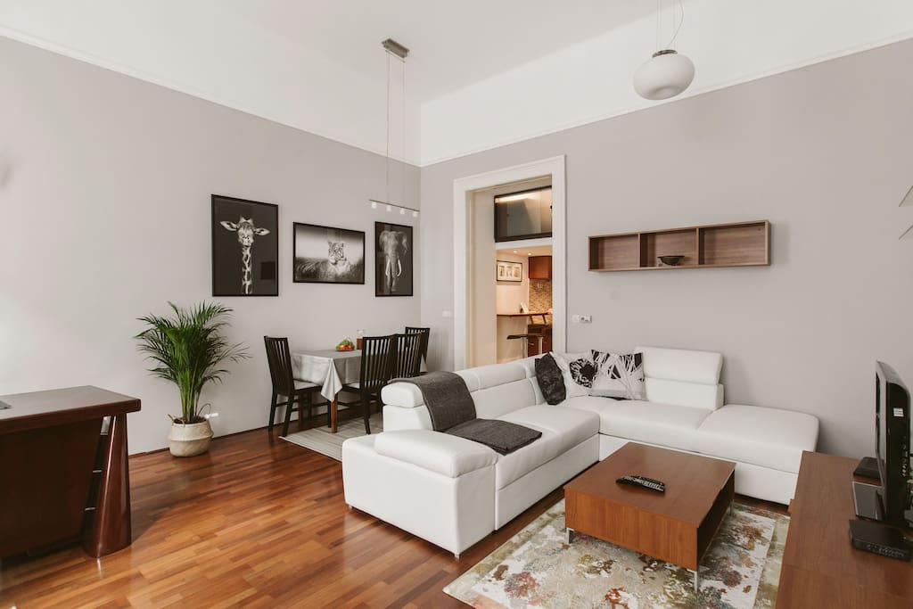 Sunny, spacious and modern living room. The white sofa turns to a comfortable double bed. Fully equipped and furnished in a really good quality.