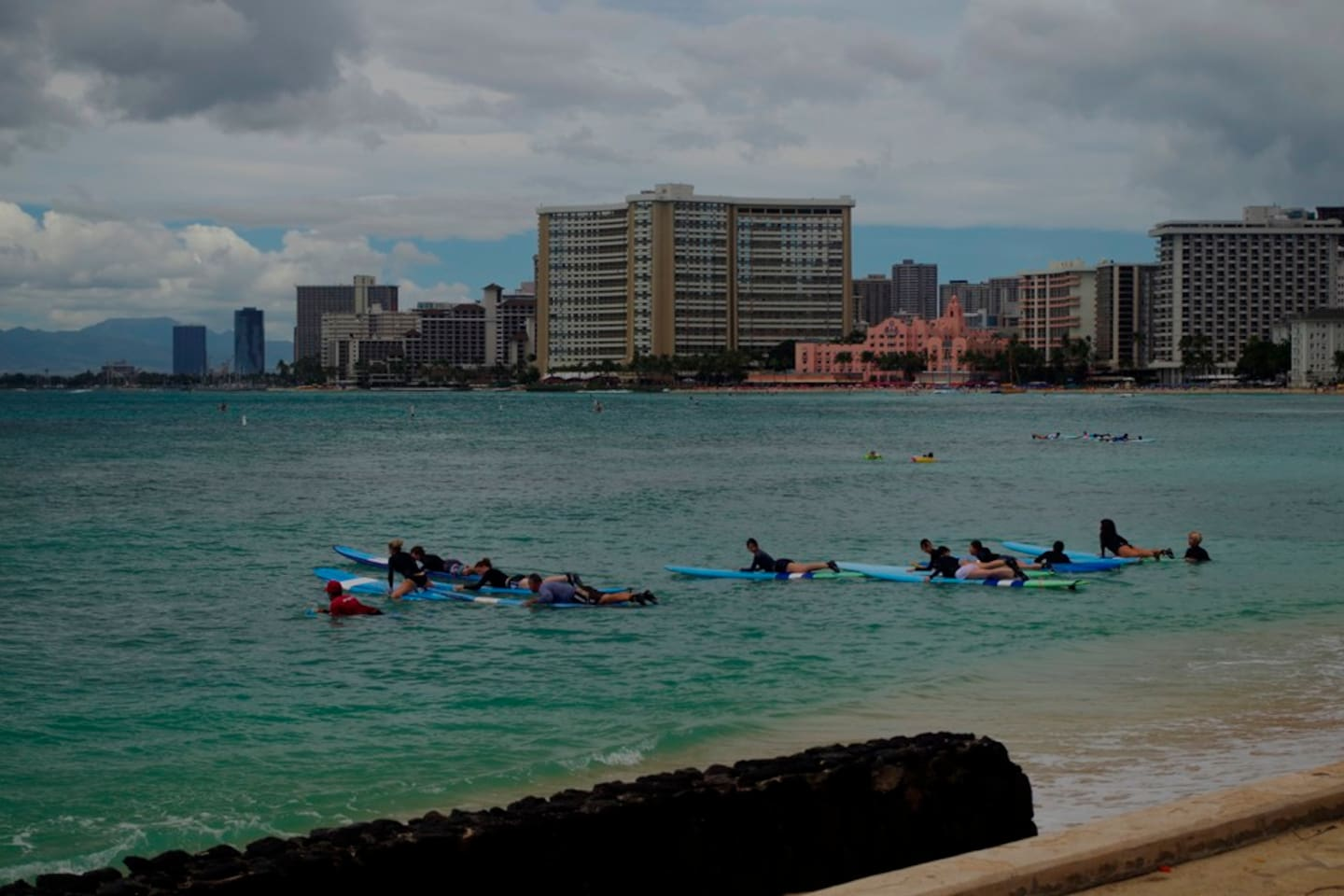 Instant easy Surfing ?. Do this.  Walks to Waikiki Beach select surfing board to rent jump in.  total  20 minutes time.