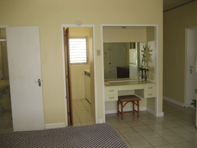 Built-in dressing area just outside the kitchenette.