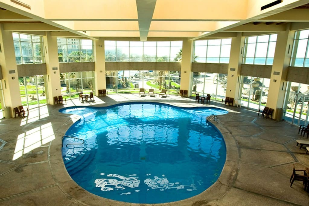 The indoor pool surrounded by windows is the perfect spot for dip no matter the weather.
