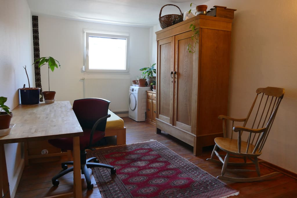 Our guestroom - with a desk space and plenty of light.