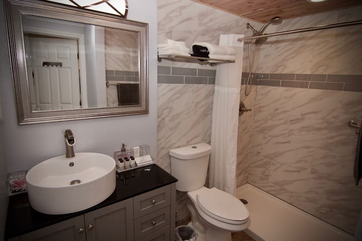 Here you can see the remodeled bathroom with shower, toilet and vanity location.  Ample space even for two at the same time.