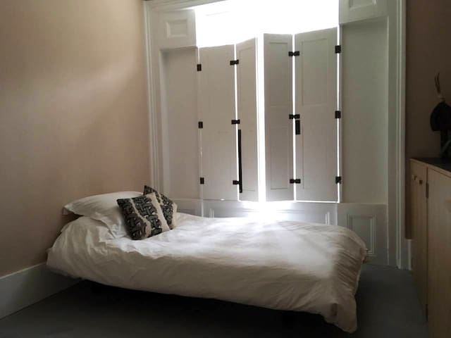 Let sunshine create chinks of magical light  when partly closing the original Victorian shutters