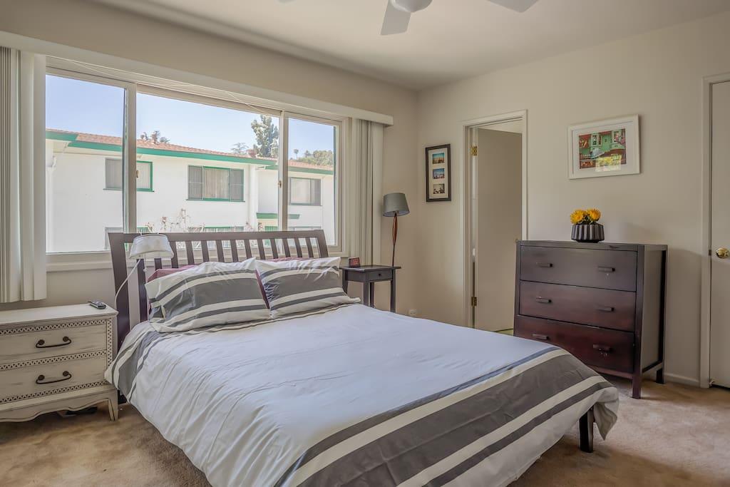 Comfortable Queen Bed in the Master Bedroom with En Suite 1/2 Bathroom