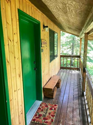 This is a photo of the front door of the additional Cougar Cabin which has two twin beds and private bath.