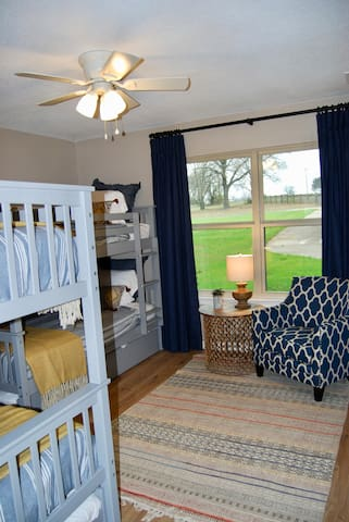 Bunk room view from doorway. Includes 4 beds and 1 trundle bed and 2 large closets.