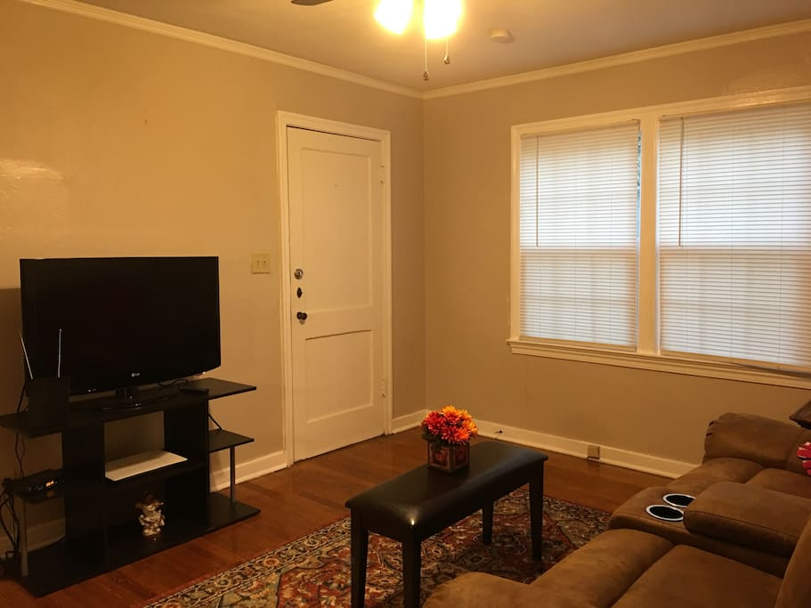 Cozy living room with cable tv and recliners.
