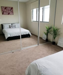 Bright en-suite master bedroom in top floor apt!