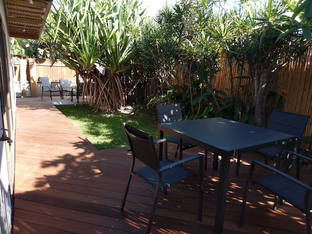 Separate private outdoor lounge area, perfect natural shade mornings and afternoon.