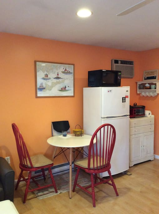 Kitchen area- equipped with a refrigerator, microwave, broiler oven/coffee pot and various kitchen supplies.