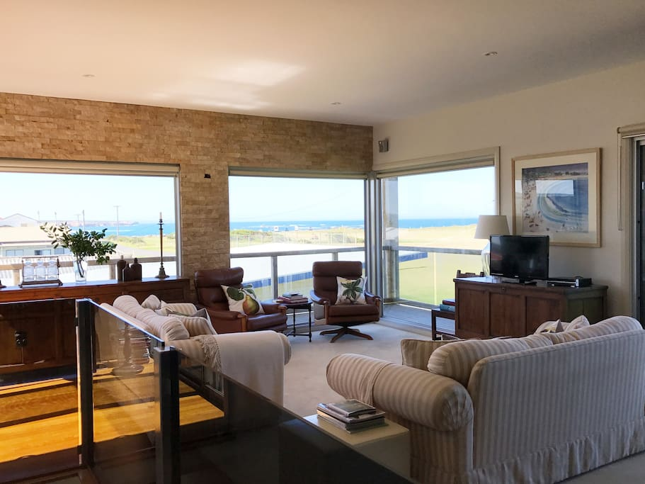 Upstairs living area with views over the golf course and ocean