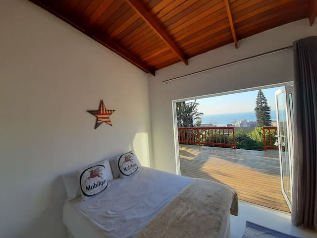 Bedroom with full sea views and walks straight out onto the deck and steps down to the pool.