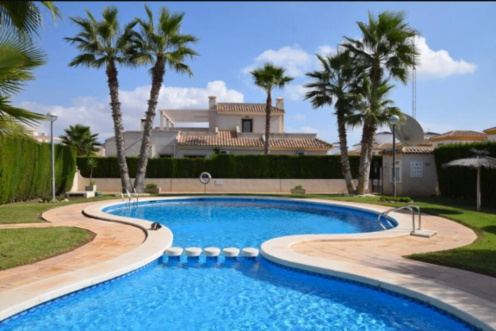 View from our Balcony of the stunning shared gated pool open from 9am to 9pm all year round