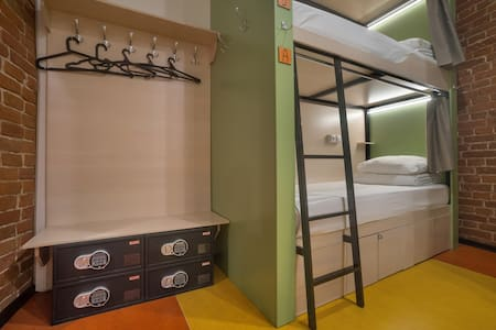 Bunkbed with local wall socket, light and curtan