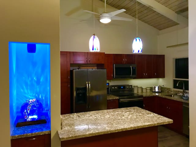 Remodeled cooks kitchen with all new Samsung appliances and granite countertops, and Minibar.