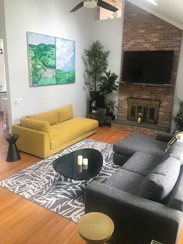 Communal living room with brand new large smart TV and working fireplace and piano. Sleeps 2 on sofa beds.
