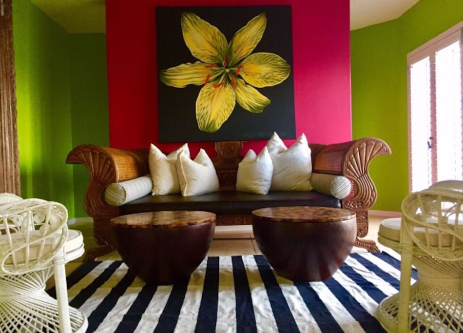 Guest lounge with vintage tropical furnishings