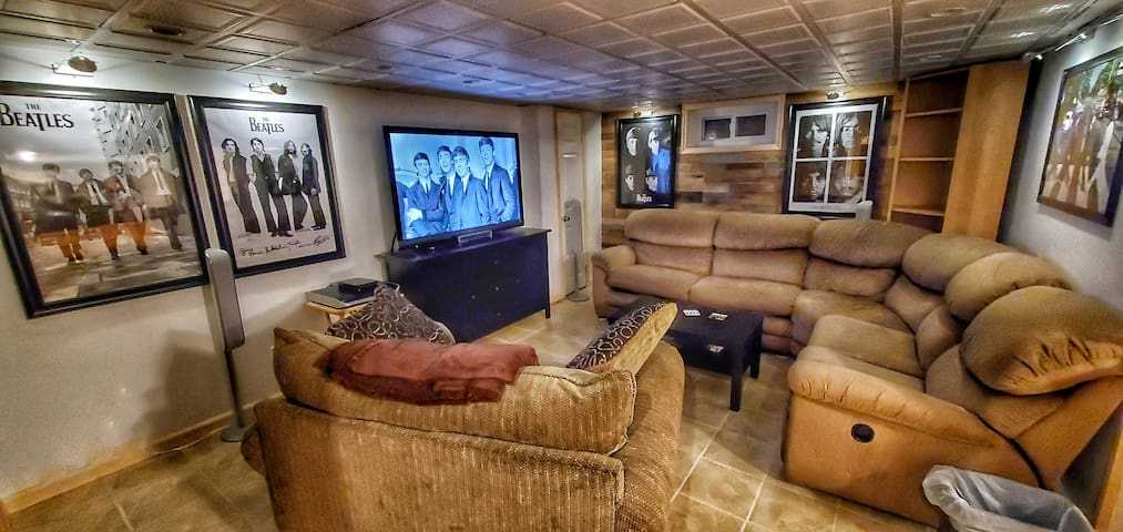 """CAVERN CLUB includes huge 55"""" TV with surround sound... And an extraordinary comfortable couch with recliner."""