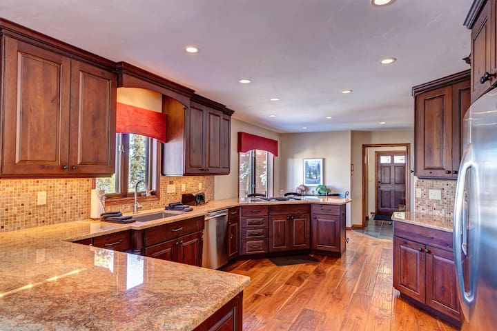 Fully stocked kitchen with granite-slab countertops