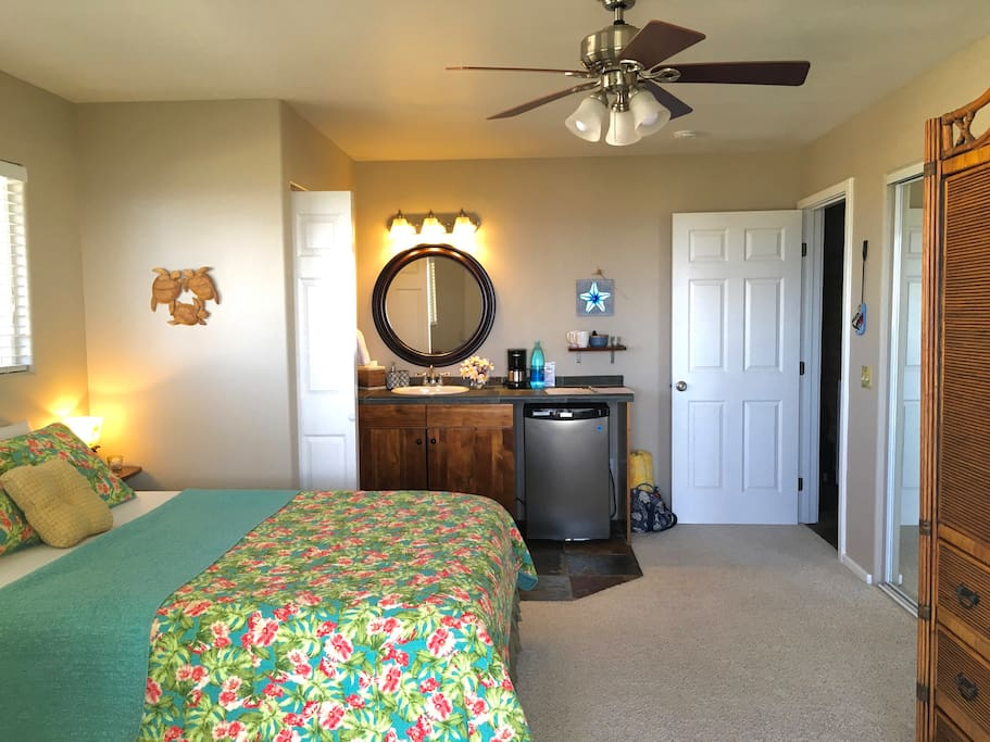 """SUITE 1.  Clean, Fresh, island inspired Tommy Bahama bedding, on the guest quoted, """"very comfy"""" Queen bed  :)  Please take a look through ALL our photos at least once, to get a feel for the space & the island! :)"""