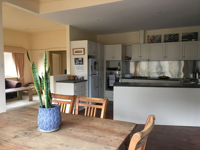 Spacious and open living, dining areas and new kitchen.