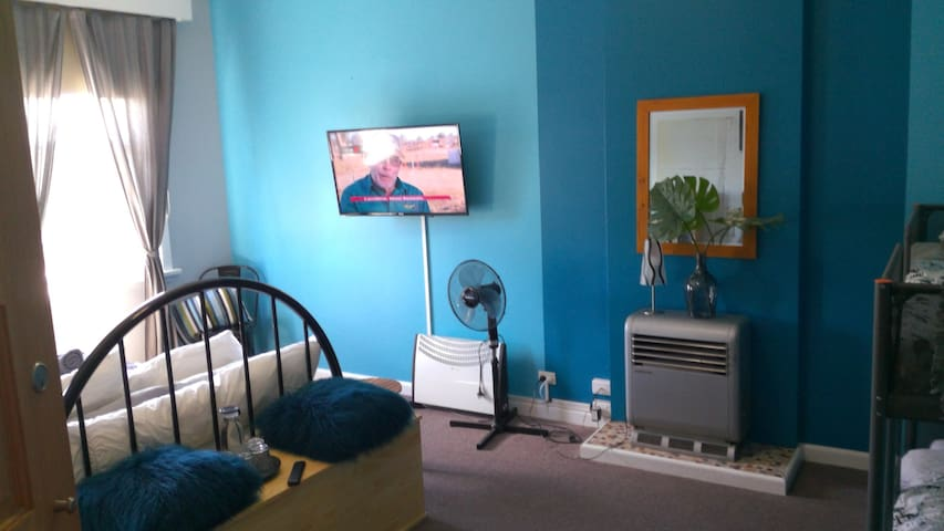 A new TV mounted on the wall for space and safety