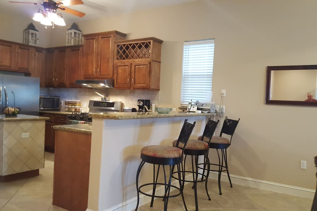 Beautiful chef kitchen with an open view into the dining and living room.  Great for entertaining!