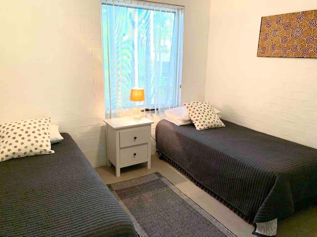 2nd room.  2 single beds