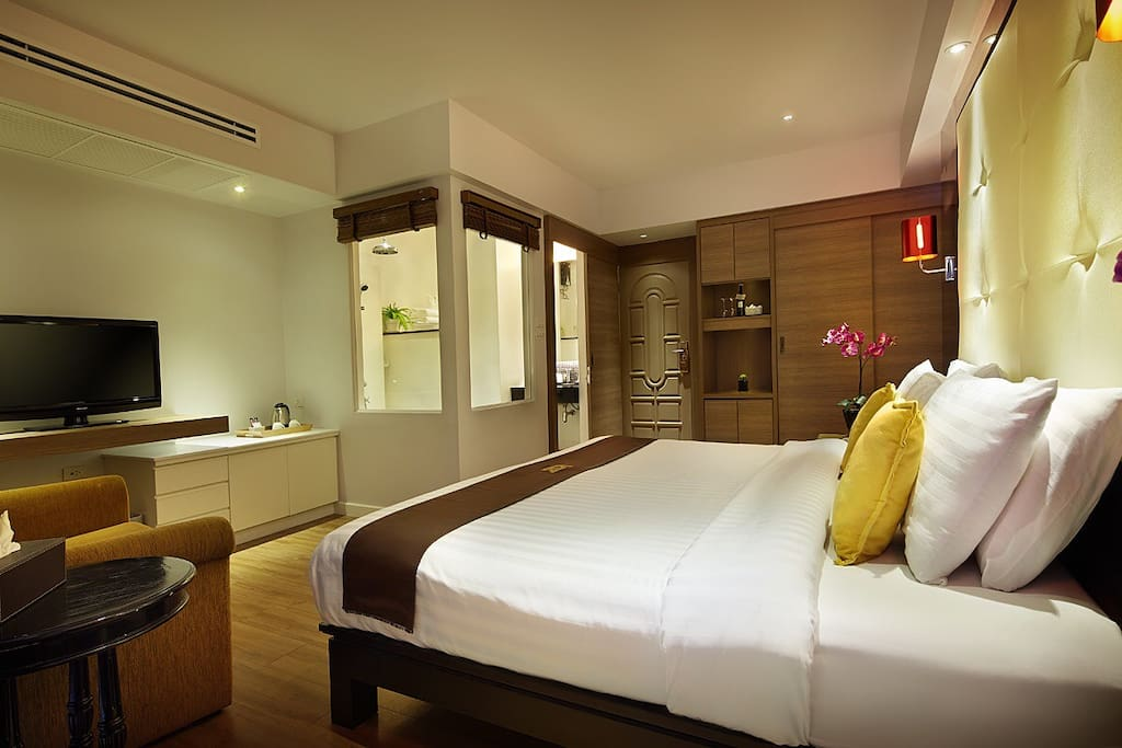 Cute Room (2) just perfect for quiet holiday away from home with private rain shower, sofa, cable TV.