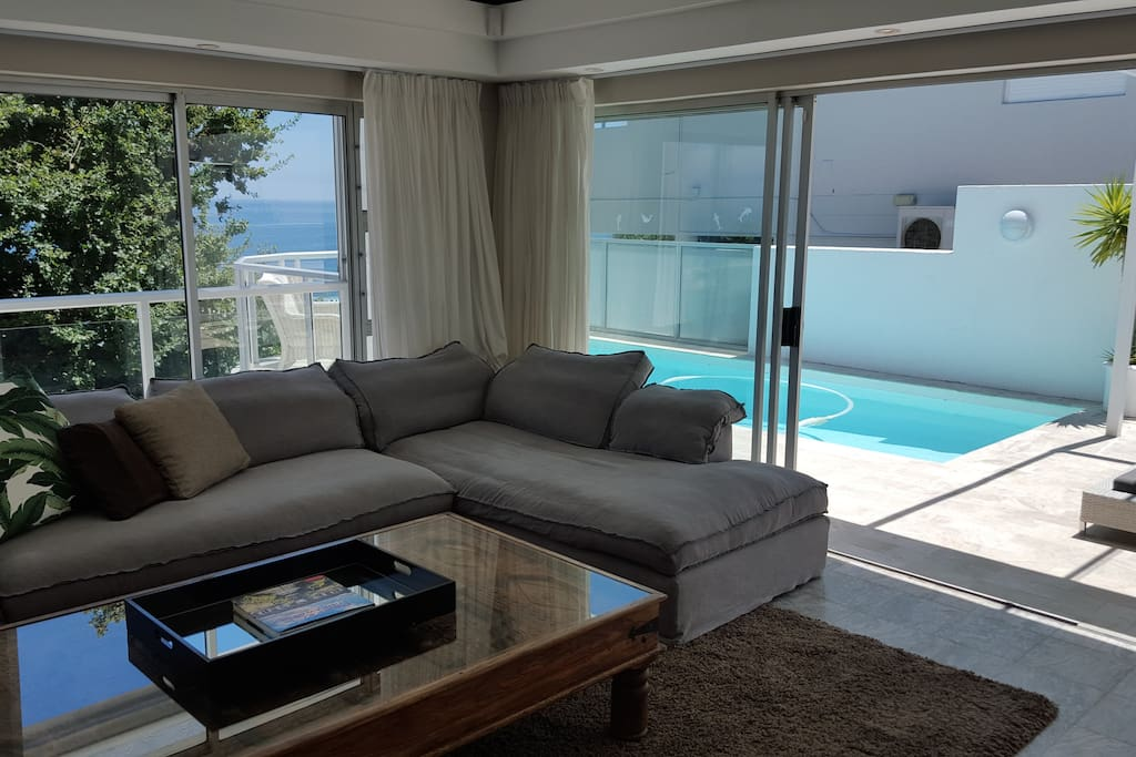 Lounge with large pool deck and barbeque area outside with 8 seater outdoor table!