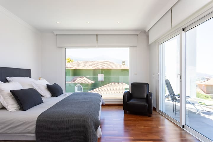 Master bedroom with balcony and ensuite bathroom
