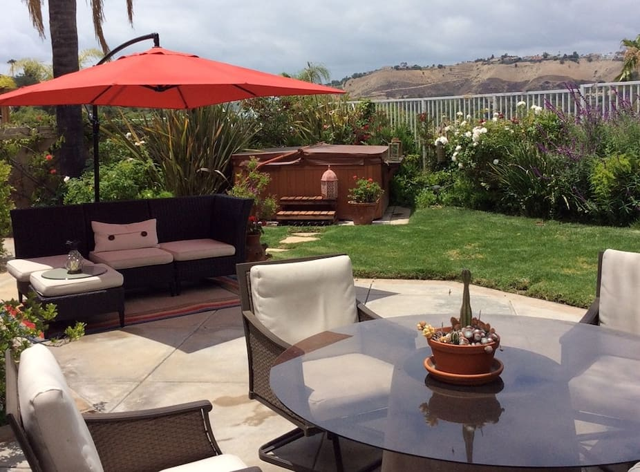 Outside dining, hot tub and hillside views