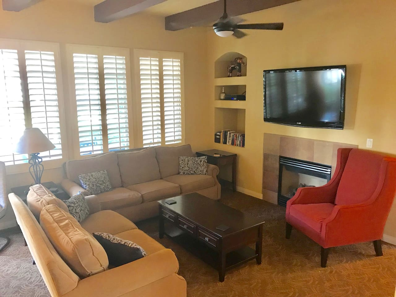 the large living space has a sofa sleeper, love seat and an additional large chair to offer plenty of seating.  A large flat screen with cable, dvd player, and a fireplace.