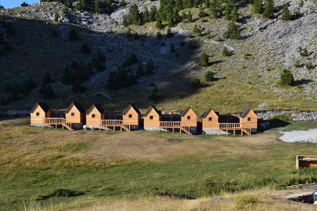Beautiful wooden guesthouses surrounded by an amphitheatre of mountains.
