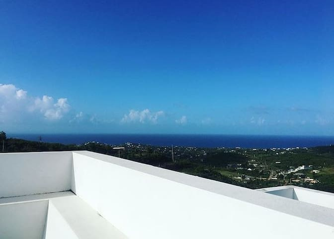 The Eagle's Nest roof deck with views of the Caribbean ocean in all directions.