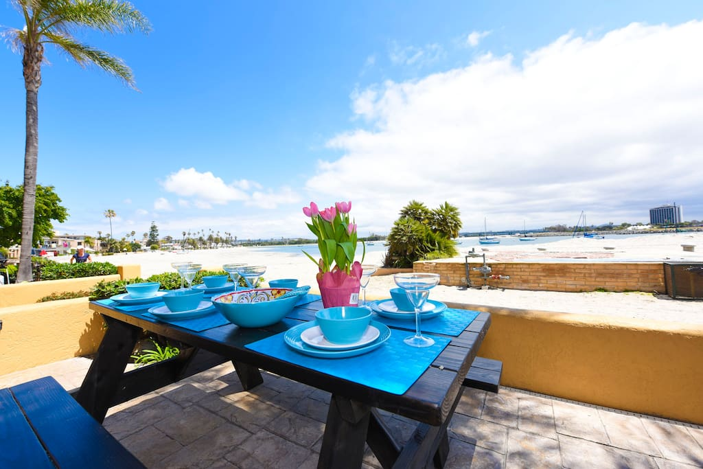 "Dine outside on the patio and enjoy the spectacular view. Picnic table seats 6 people. Melamine outdoor dishes included. ""The location is amazing, and we loved being right on the beach."" - Oystein (guest)"