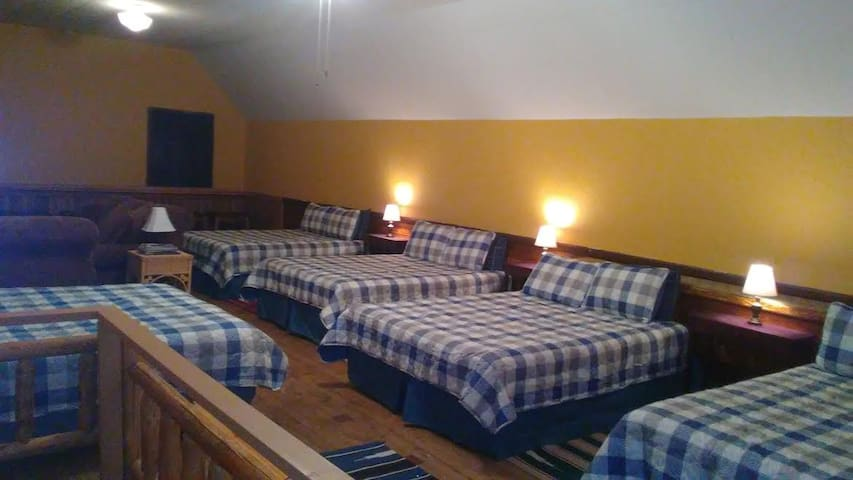 The Bunkhouse (hostel-style space).  5 Queen beds.