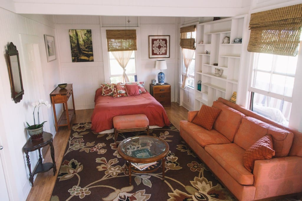 View Of Queen Bed and Couch Area