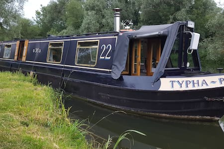 Narrowboat in The Old Riverport, St. Ives, Cambs.