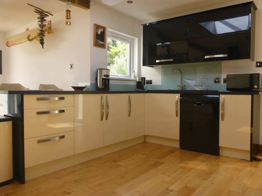 Well equipped kitchen with dishwasher, american fridge freezer and plenty of storage.