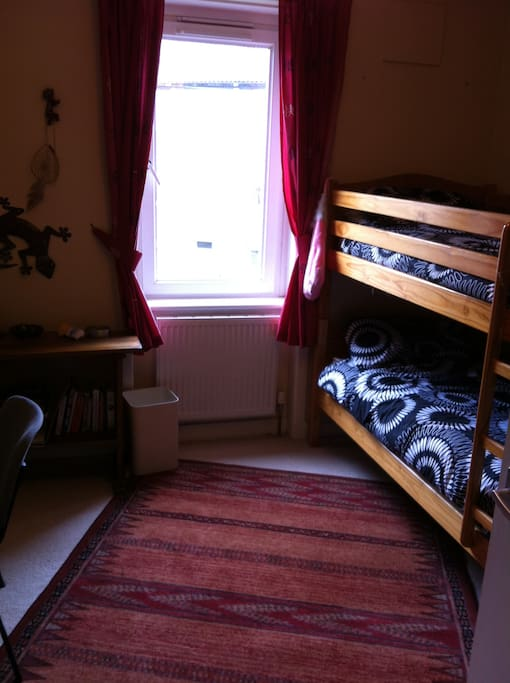 Nice room bunk beds and library of guide books and Scottish History