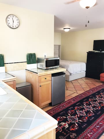 Kitchenette with coffee and tea selections available. Microwave and mini fridge