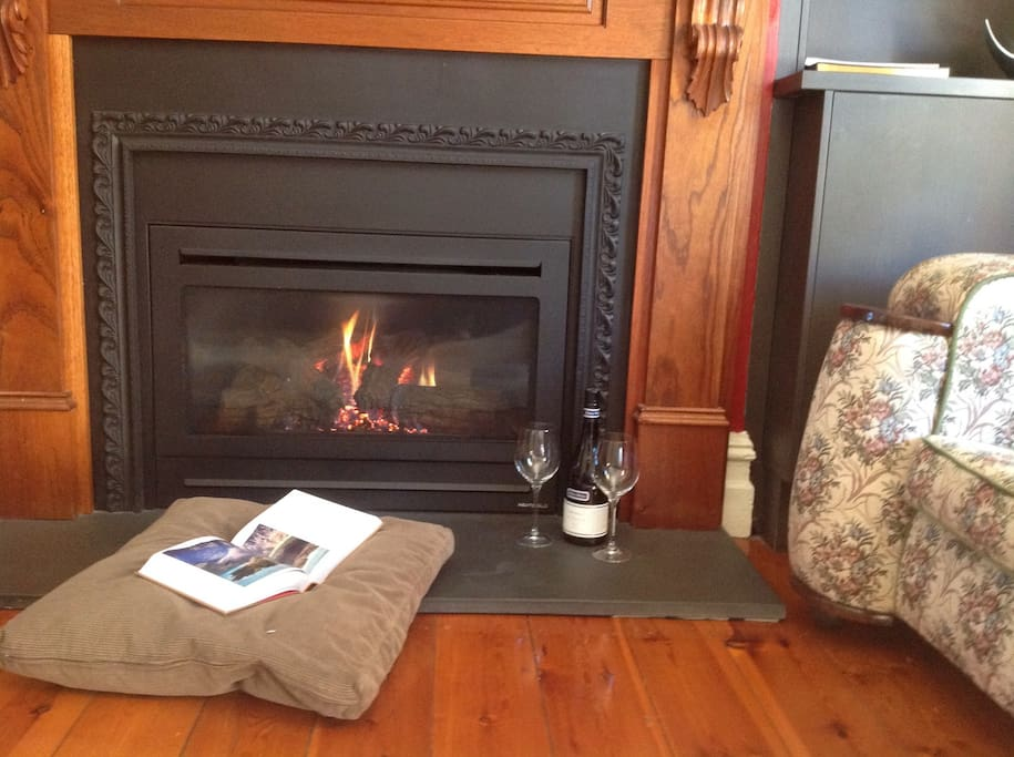 Snuggling up to the beautiful, warm fireplace with a delicious wine and a good book in Winter....nothing better!