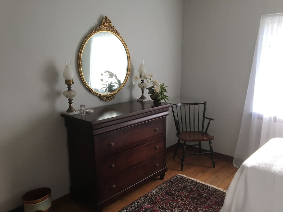 Generous dresser, matching Hitchcock chair in first floor bedroom.