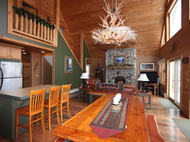 Open floor concept allowing you to enjoy your company, big screen TV and river rock fireplace.